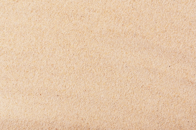 Plage de sable doré sur fond de bord de mer. texture sable.