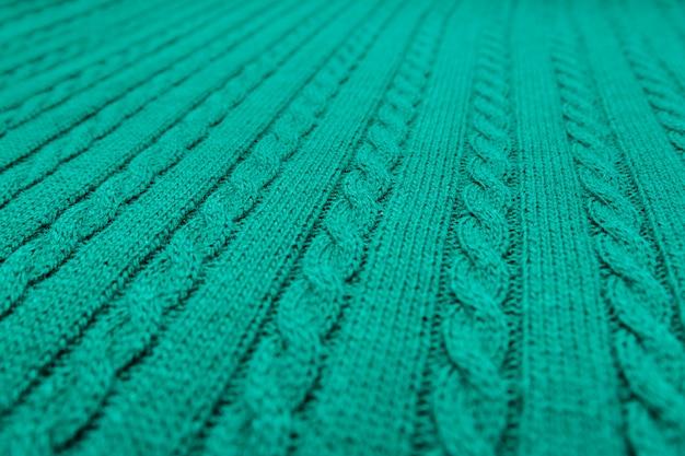 Plaid vert, queue de cochon tricoté.