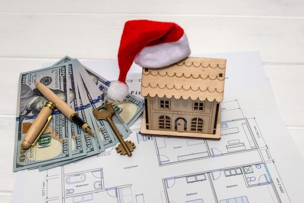 Plan de maison avec modèle de maison, dollars et clé