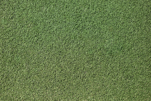 Plan rapproché d'herbe verte artificielle