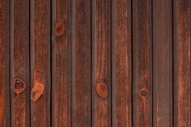 Une planche de bois. belle texture. vieille porte en bois marron texturé