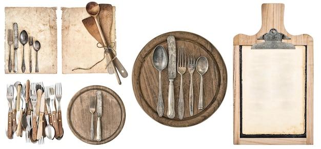 Planche de cuisine, papier de recette vieilli et couverts vintage isolés sur fond blanc. ensemble d'ustensiles de cuisine. notion de nourriture