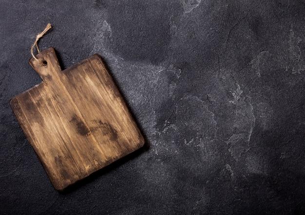 Planche à découper en bois vintage. concept de cuisine de cuisine.