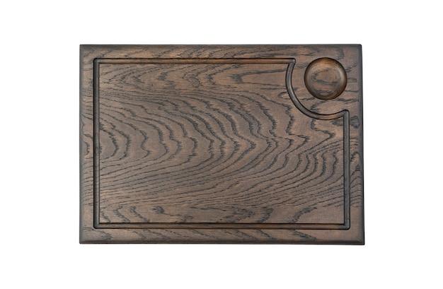 Planche à découper rectangulaire en bois naturel isolé sur fond blanc. vue de dessus avec espace pour copier. concept d'accessoires de cuisine.