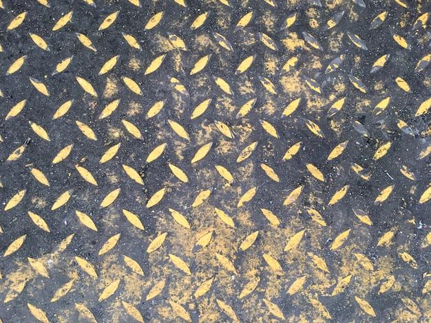 Plancher en acier de fond abstrait dans une usine industrielle