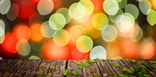 Plancher en bois avec fond abstrait chistmas de bokeh de lumière