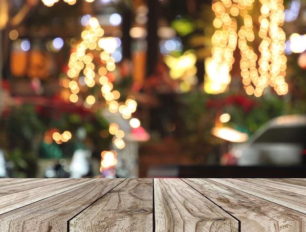 Plancher de table en bois et fond de bokeh de noël.