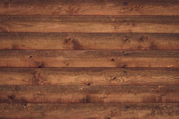 Planches de bois brun minable. texture de bois de planche. clôture sale en chêne vintage, table. fond de texture de plancher grunge.
