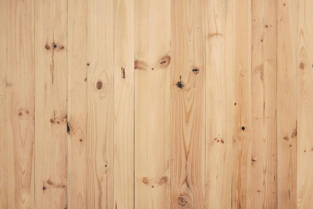 Planches de bois rabotées récupérées non tachées brutes fond jaune chaud