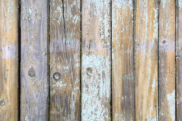 Planches de texture en bois à l'extérieur de la surface de pelage minable avec peinture légère