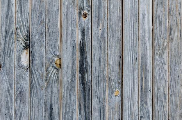 Planches vintage gris foncé. verticalement arrangé. texture. surface