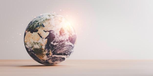 Planète sur table en bois avec espace de copie pour le jour de la terre et concept d'environnement d'économie d'énergie, élément de cette image de la nasa et rendu 3d.