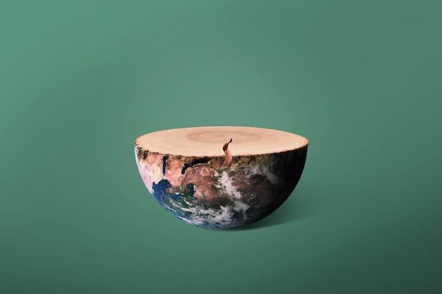 Planète terre et arbre abattu avec anneaux, concept. préserver l'environnement et abattre des arbres. souche de bois créative et terre. écosystème et écologie