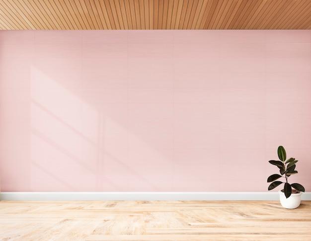 Plante contre un mur rose