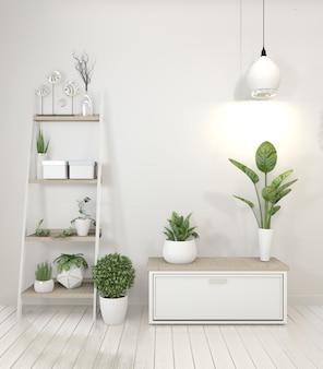 Plantes de décoration sur armoire à l'intérieur du salon blanc.