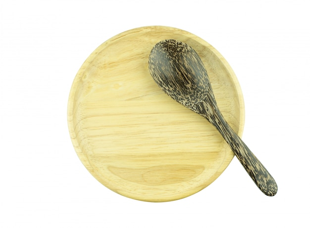 Plaque de bois et cuillère isolé vue de dessus
