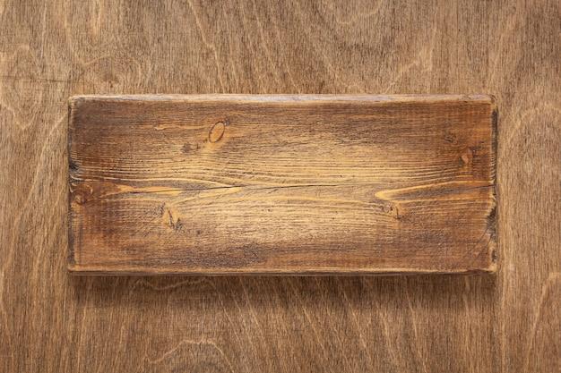 Plaque signalétique en bois vieilli ou plaque signalétique à la surface de la texture de fond en bois