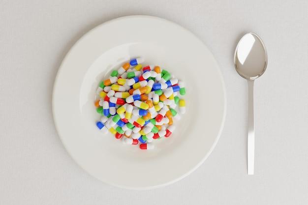 Plat plein de pilules à côté d'une cuillère sur blanc, vue du dessus