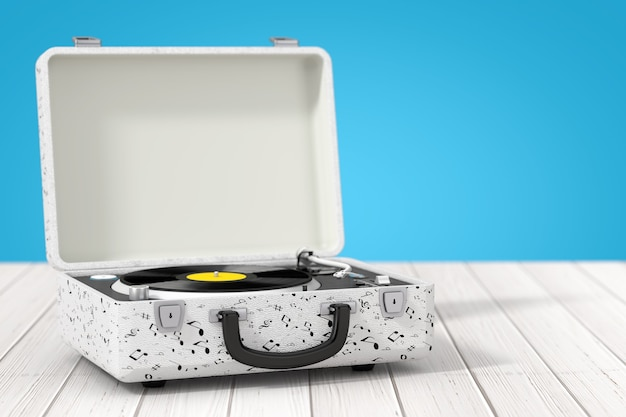 Platine vinyle portable de style vintage dans un boîtier blanc sur une table en bois. rendu 3d