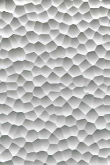 Plâtre blanc texturé avec fond de cellules