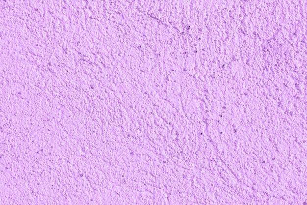 Plâtre décoratif de couleur violette. fond, texture