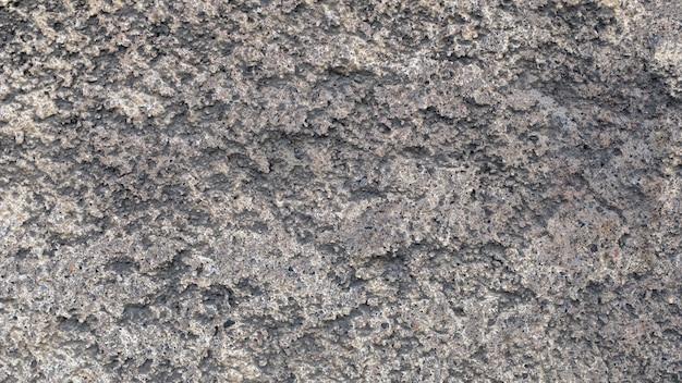 Plâtre de rue gris. texture irrégulière. arrière-plan pour la conception. photo de haute qualité