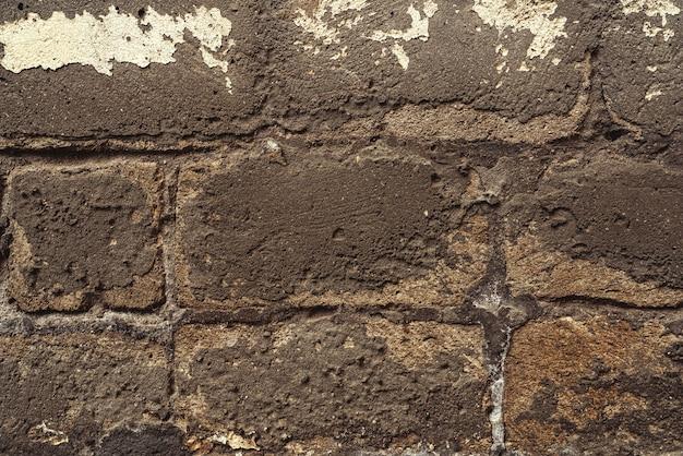 Plâtre tombé sur fond de mur de maison