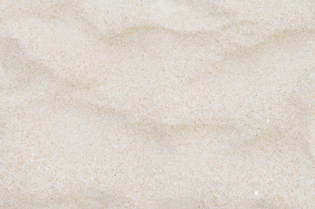 Plein cadre tourné gros plan de la texture de sable sur la plage.