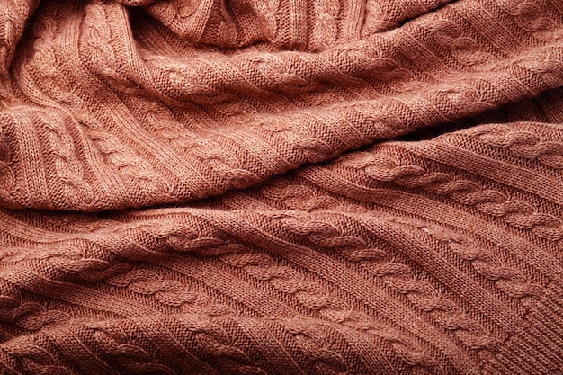 Plis d'une couverture en laine tricotée, vue de dessus