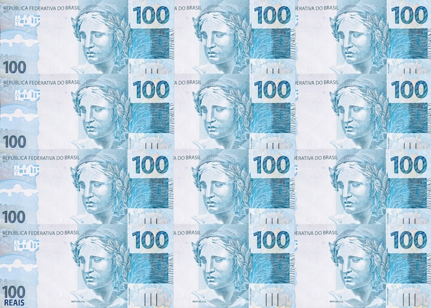 Plusieurs billets de cent reais du brésil, texture de l'argent brésilien, notes de surface de reais