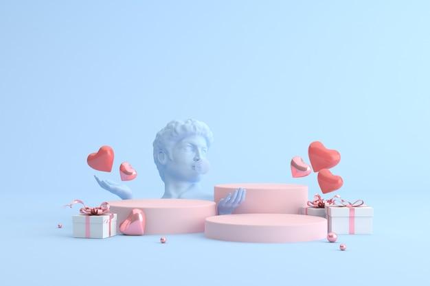Podium de coffret cadeau avec ballons coeur et sculpture humaine, présentation du produit.