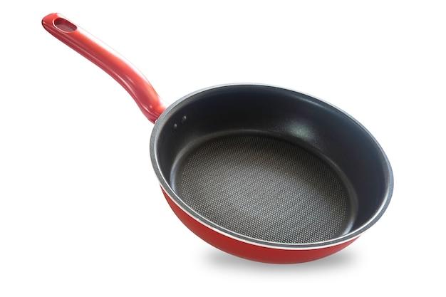 Poêle à frire de couleur rouge isolé