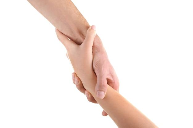 Poignée de main d'amitié isolée sur blanc