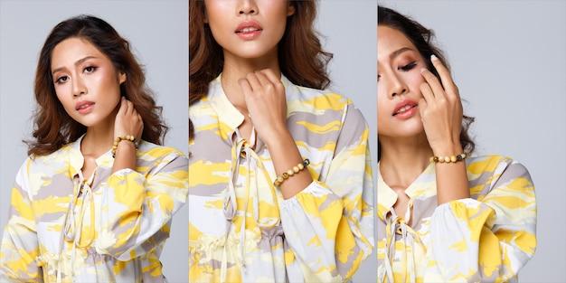 Poignet de pierre de perles sur la main de belle femme asiatique. gros plan sur le sortilège de bracelet magique chanceux par des personnes célèbres de l'horoscope et de l'astrologie de l'amour. concept de chose vodoo décorée dans le ton jaune
