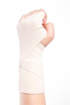Poignets féminins attachés avec un bandage élastique