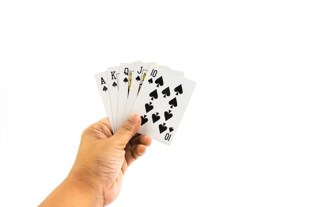 Poker bêche straigt couleur dans la main de l'homme isolé