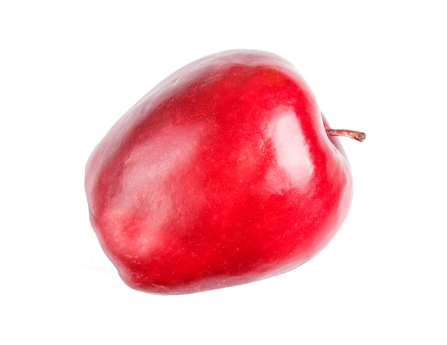 Une pomme rouge isolée sur une surface blanche