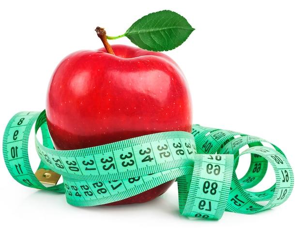 Pomme rouge avec ruban à mesurer