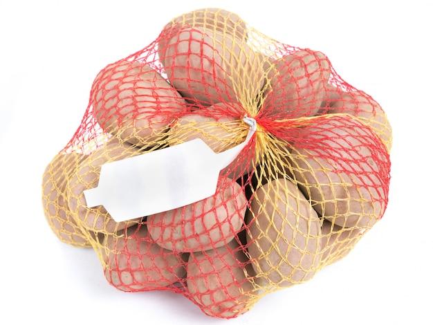 Pommes de terre mûres dans un sac à cordes