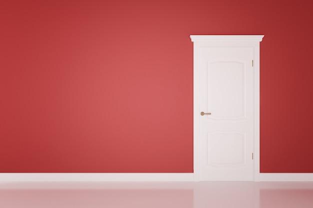 Porte blanche fermée sur la surface du mur rouge