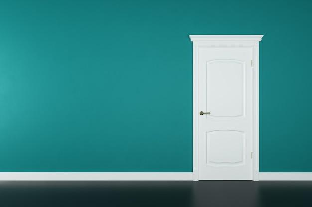 Porte blanche fermée sur la surface du mur vert