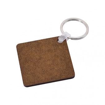 Porte-clés blanc isolé sur fond blanc. porte-clés pour votre conception.
