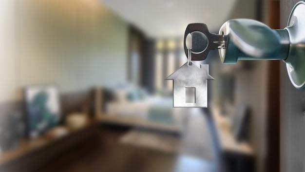 Porte ouverte avec clé en trou de serrure vers l'intérieur du salon intérieur moderne
