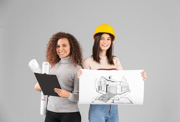 Portrait D'architectes Sur Mur Gris Photo Premium