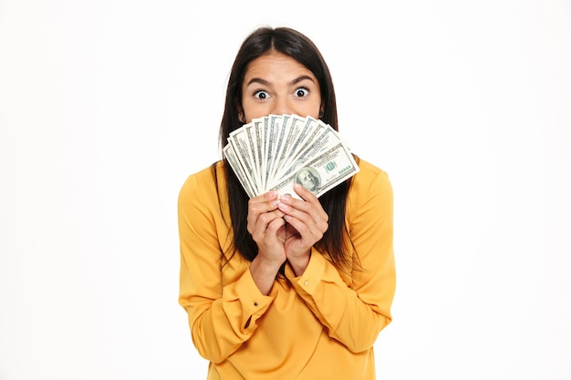 Portrait, excité, femme, tenue, tas, argent