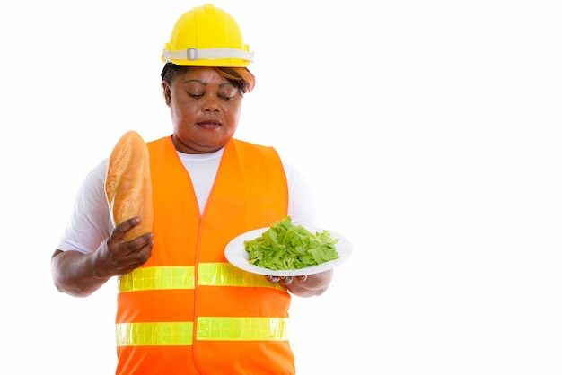 Portrait, de, femme africaine, tenue, nourriture, porter, casque
