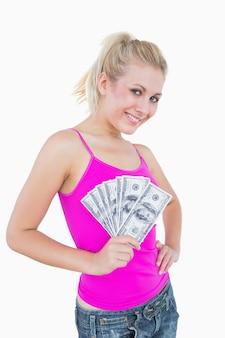 Portrait, heureux, femme, tenue, éventé, nous, billets banque