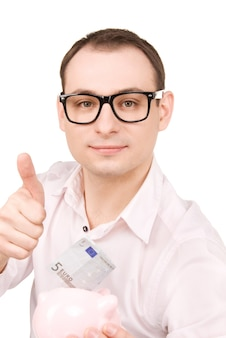 Portrait d'homme d'affaires avec tirelire et argent
