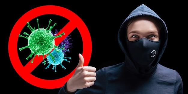 Portrait d'une jeune fille dans un masque de protection qui montre son doigt dans le contexte du panneau d'arrêt des virus