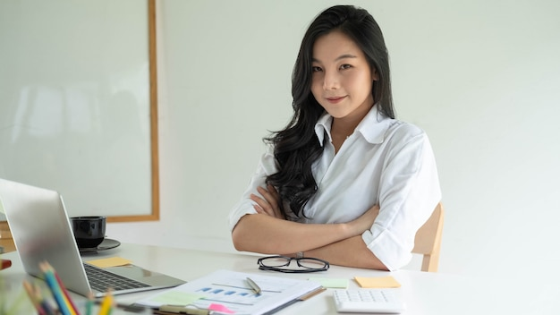 Portrait of attractive asian young business entrepreneur woman working at modern office
